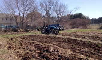 Christina Dedora on tractor. Back field preparation with chisel plow. First of the season! | Blue Skys Farm, Cranston RI