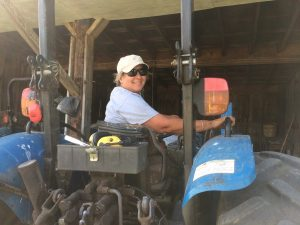 Christina on the tractor